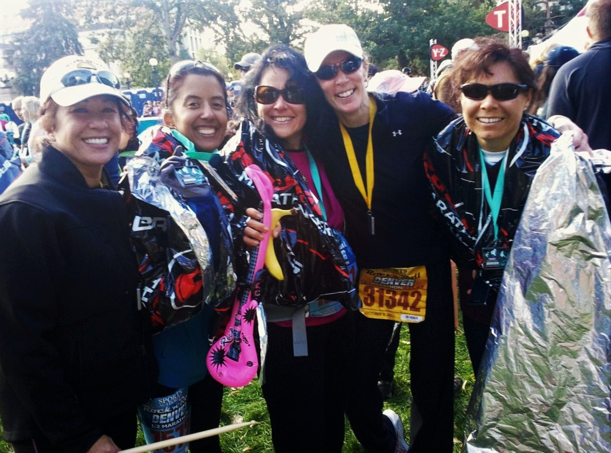 5 woman runners at the Denver Rock N Roll Half Marathon after finishing the race