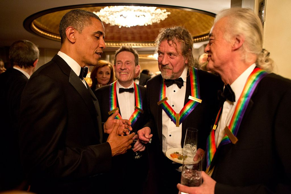 Robert Plant, Jimmy Page, and John Paul Jones of Led Zeppelin at the Kennedy Center being honored and meeting President Obama.