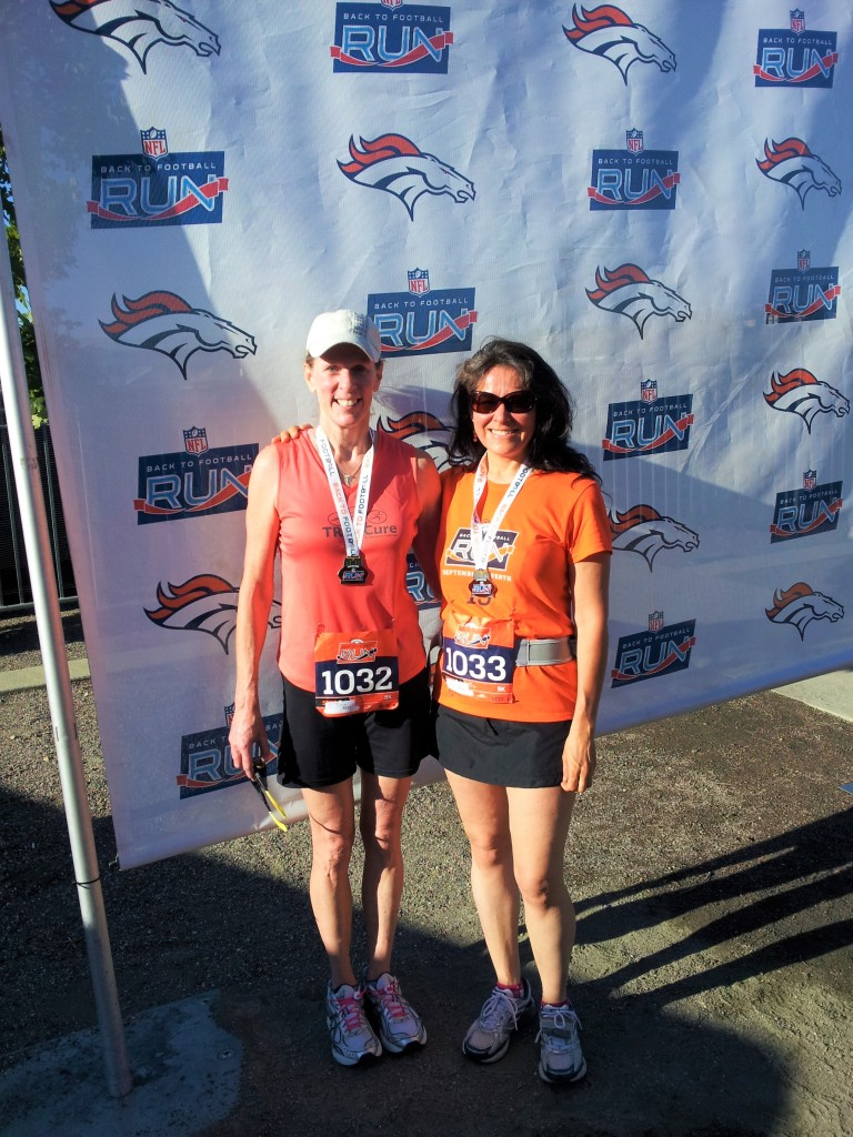 two women after running a 5K race in Denver