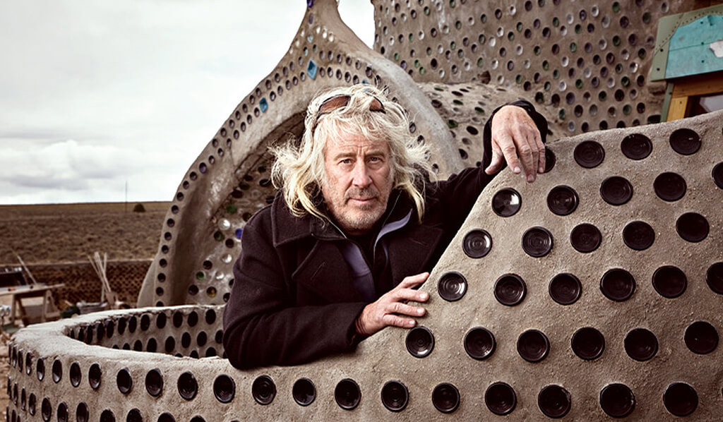 Michael Reynolds in one of his Earthships, book review