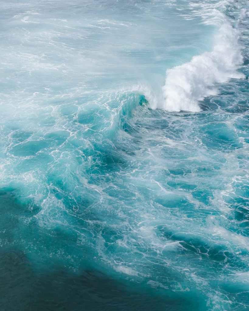 sea waves splashing near the shore.