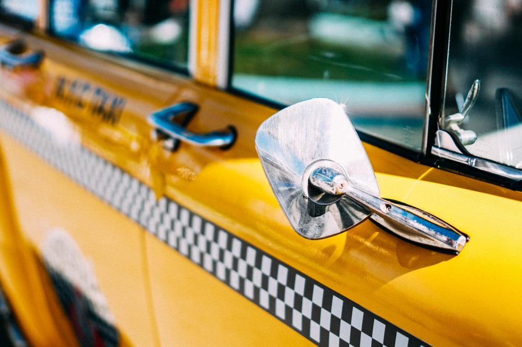 The side door of a yellow taxi cab in New York City.